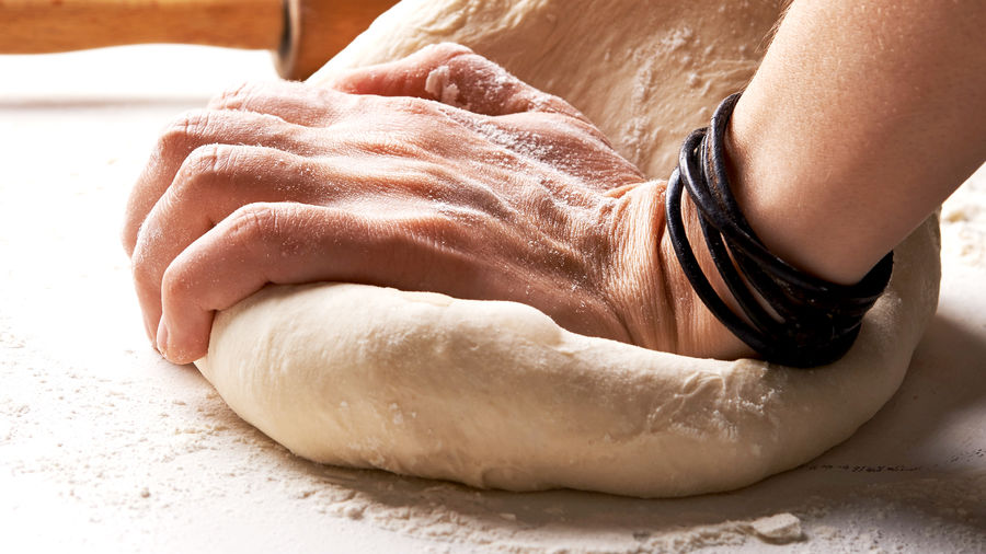 Cover Photo: An image of a hand kneading dough with intent.