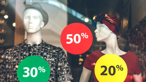 Cover Photo: Two human mannequins modeling clothes in a shop window covered with stickers advertising a sale and price discounts