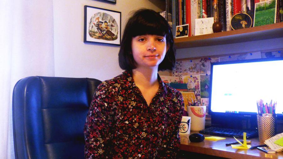 Cover Photo: Catapult October artist, Hannah Lock, sitting at her desk