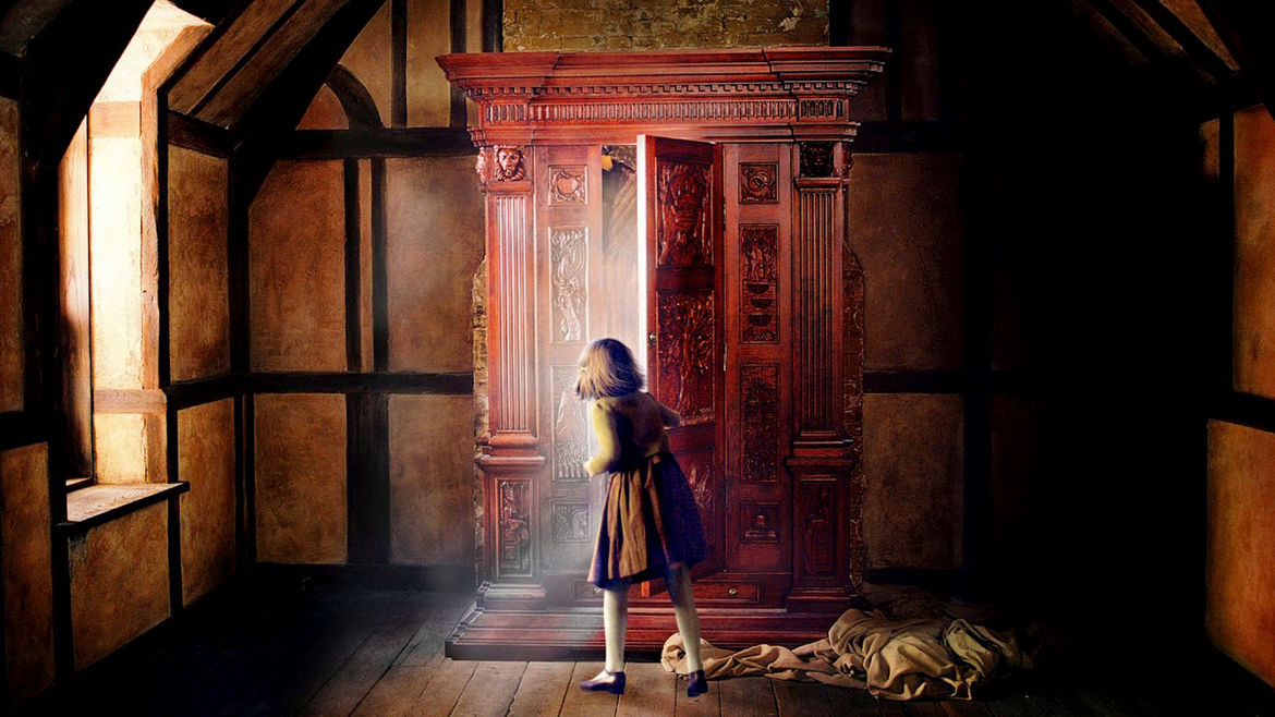 Cover Photo: An image from the film 'The Chronicles of Narnia: The Lion, the Witch, and the Wardrobe' featuring a young girl opening the titular wardrobe that leads her into a fantasy world