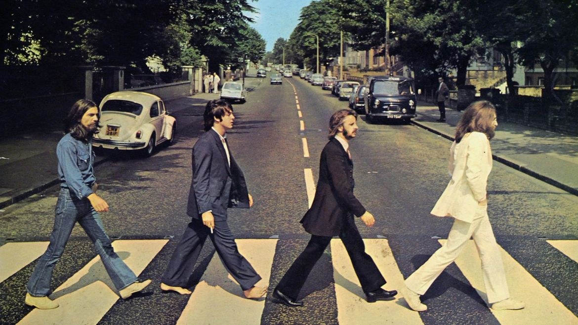Cover Photo: An image of the iconic Abbey Road album in which all the Beatles cross the street