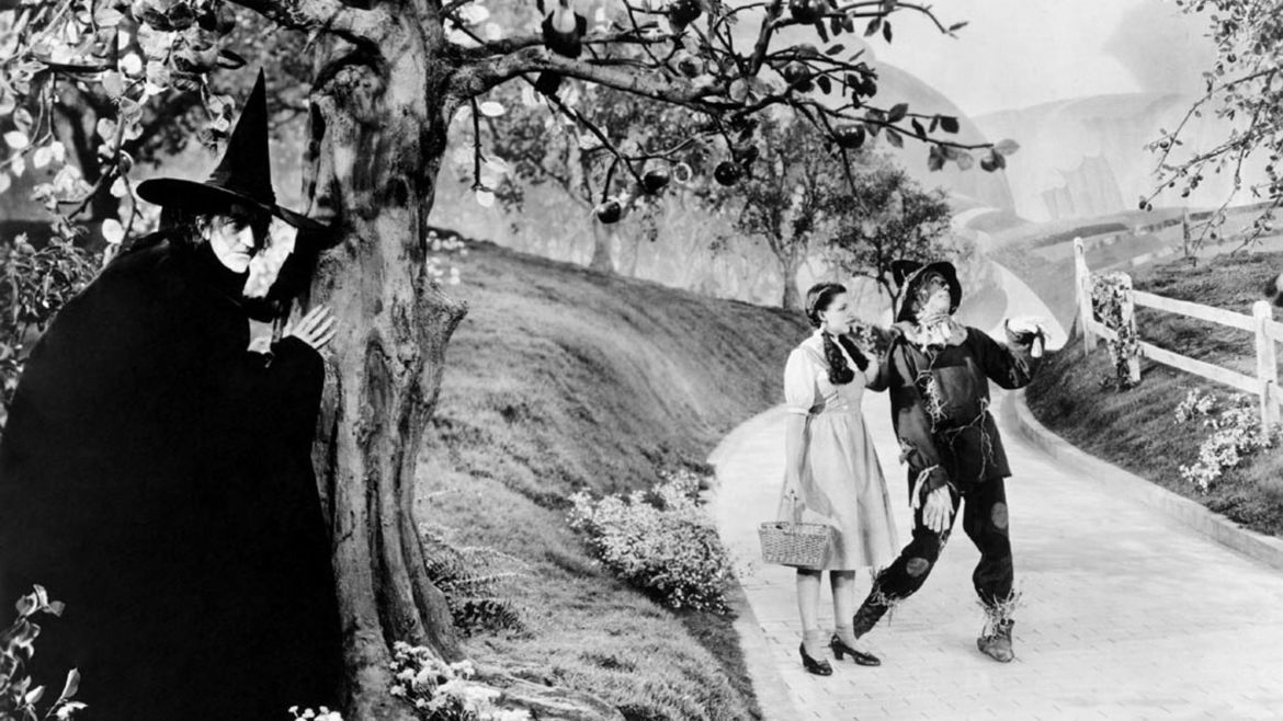 Cover Photo: A black and white still from the Wizard of Oz movie—The Wicked Witch is hiding behind a tree, waiting to surprise Dorothy and the Scarecrow, walking down the yellow brick road.
