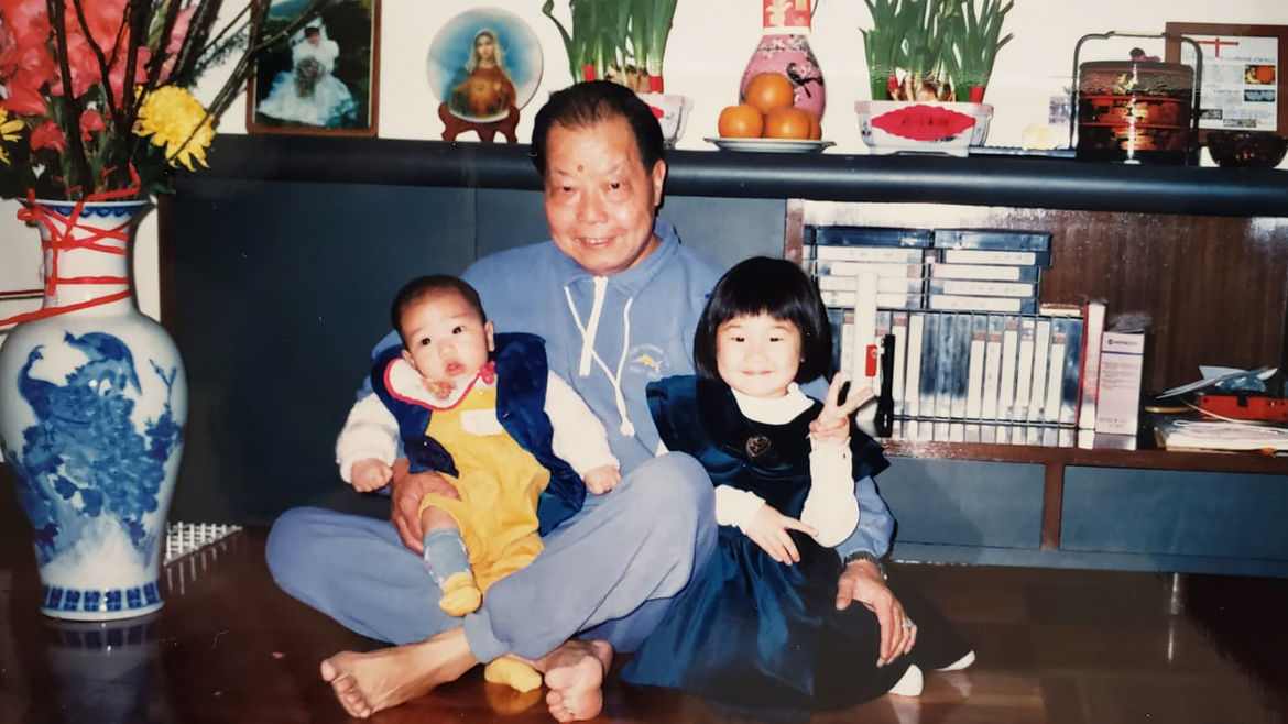 Cover Photo: A childhood photo of the author with her baby cousin, both being embraced by their grandfather