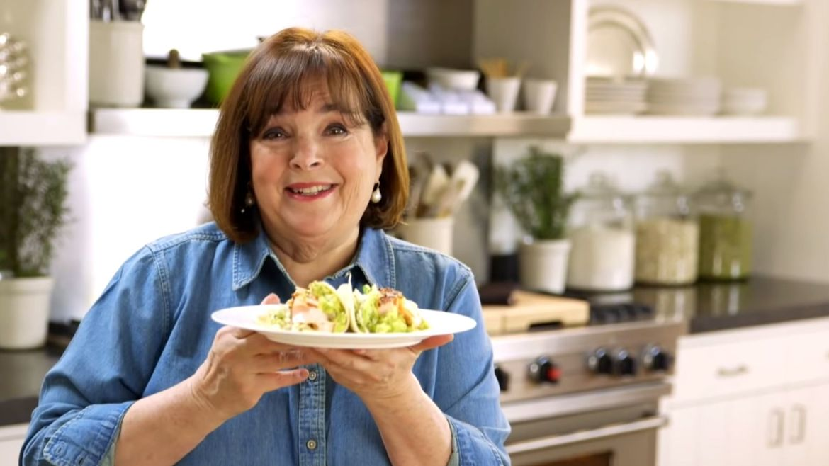 Cover Photo: A screencap of Barefoot Contessa, in which Ina Garten, smiling as if the viewer is the only person in the world, holds up a plate of chicken wraps in offering.