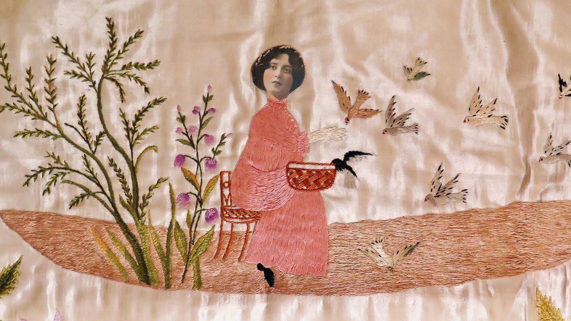 Cover Photo: Photograph of an embroidery panel created by the author's grandmother, featuring a young woman feeding birds, surrounded by flowering plants; the face of the young woman is taken from an old photograph of the author's grandmother