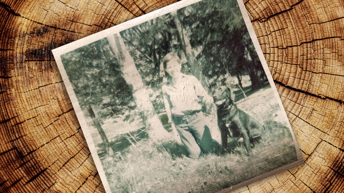 Cover Photo: The photo, courtesy of the author, is described in the essay: her mother kneeling, wearing high-waisted '70s jeans with a blouse tucked in, and a pixie cut. She is grinning and has her arm slung around her dog Smoky, who is sitting, also grinning, his chin up. He is all black with a shock of white on his chest