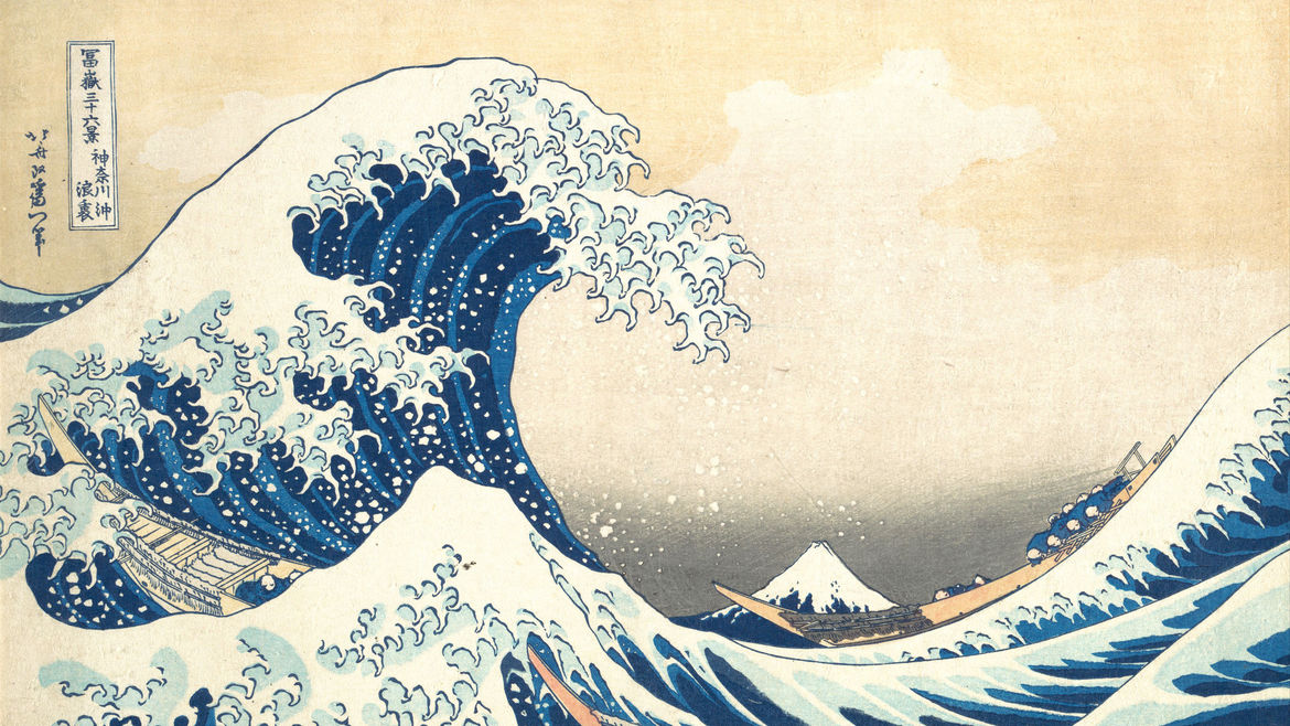 Cover Photo: An image of a wave in the ocean in the foreground and a snow-capped mountain in the background