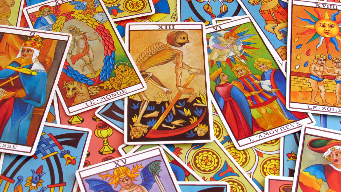 Cover Photo: An image of colorful tarot cards that overlap one another