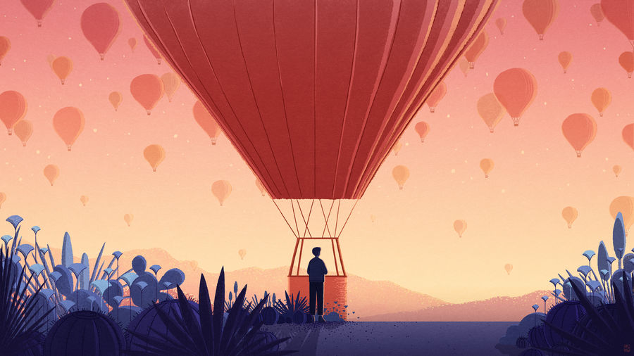Cover Photo: A man about to ride a hot air balloon