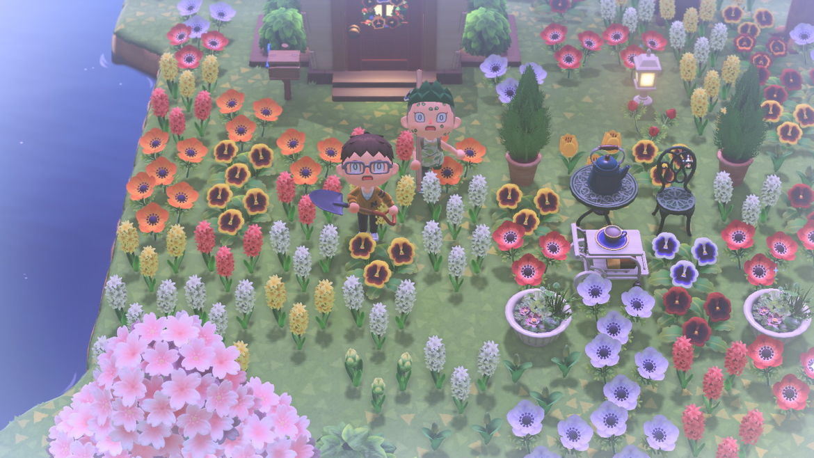 Cover Photo: A screencap of an Animal Crossing game—two cute villagers look up in shock as though at a passing plane, surrounded by hundreds and hundreds of flowers of all color and type.