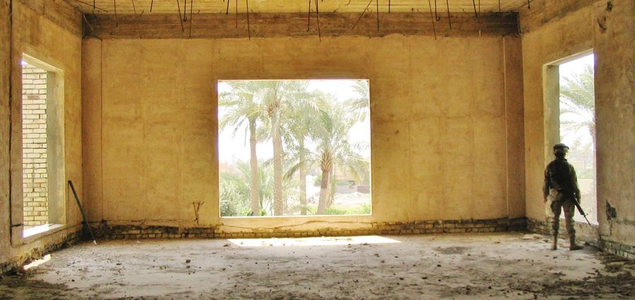 Cover Photo: Uday Hussein's old fishing home on the Euphrates | Ramadi, Iraq (2005).