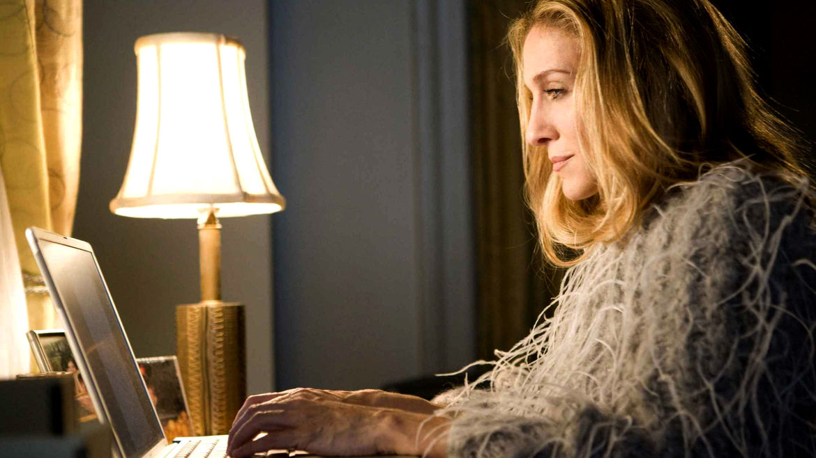 Cover Photo: an image of Sarah Jessica Parker as Carrie Bradshaw in 'Sex and the City,' working on a laptop