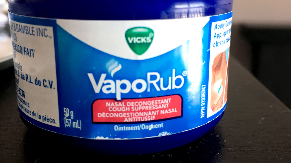 Cover Photo: A photograph of a small jar of Vicks VapoRub