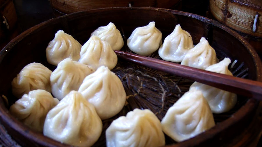 Cover Photo:  xiao long bao in a bamboo steamer