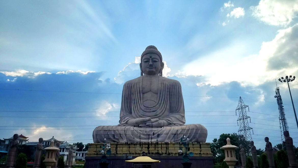 Cover Photo: A photograph of a massive statue of the Buddha in Bodh Gaya, India