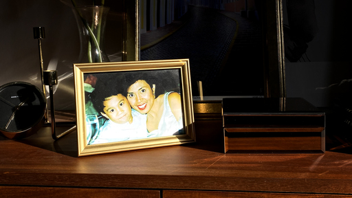 Cover Photo: photograph of a gold-framed photograph of the author as a child, with his mother, on a shelf also containing a clock and a wooden jewelry box with a vase and framed art behind