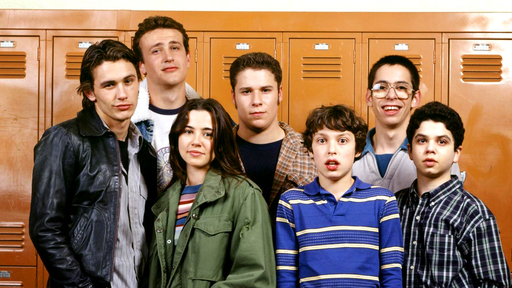 Cover Photo: the cast of the show 'Freaks and Geeks' in front of a row of orange lockers