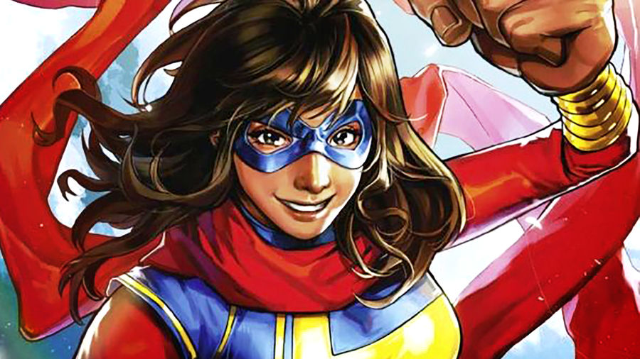 Cover Photo: cover comic illustration of Kamala Khan as Ms. Marvel, grinning with one fist extended in the air