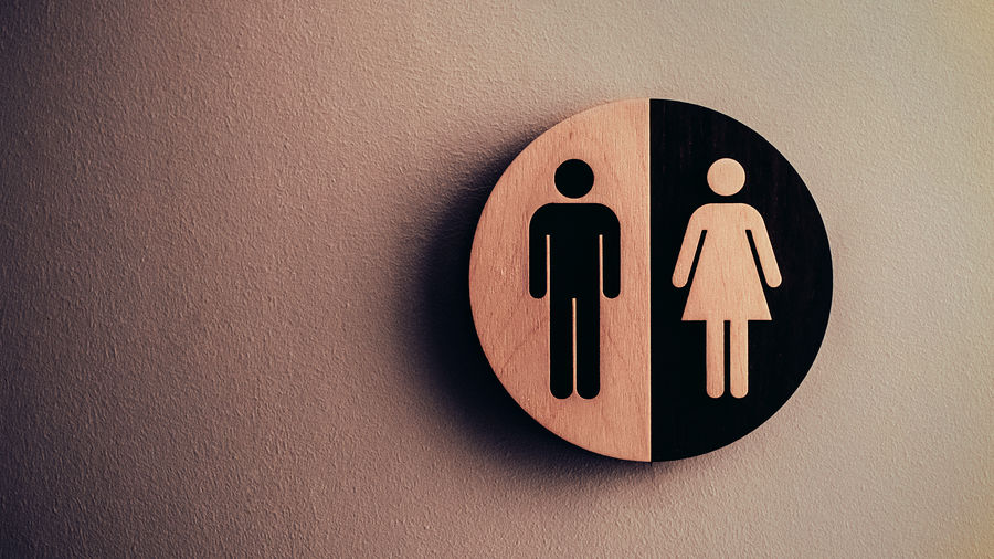 "Cover Photo: A restroom sign depicting the binary of two genders, what society considers ""man"" and ""woman"""