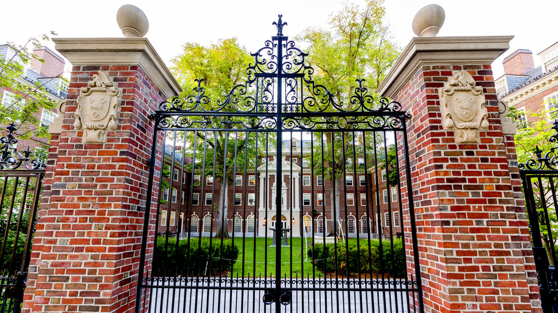 Cover Photo: red-brick and wrought-iron gates at Harvard University