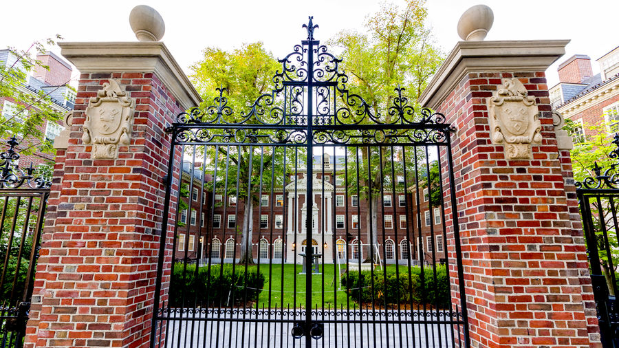 Cover Photo: red-brick and wrought-iron gates at Harvard University