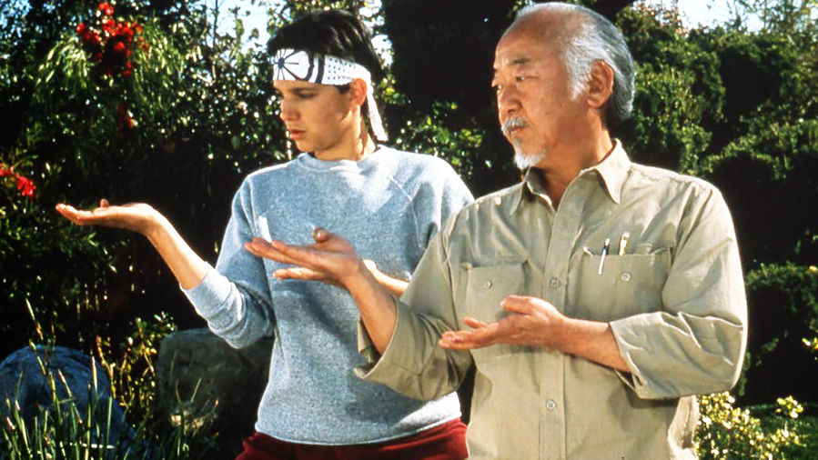 Cover Photo: A screengrab from the Karate Kid featuring Mr. Miyagi (played by Pat Morita) and Daniel LaRusso (played by Ralph Macchio)