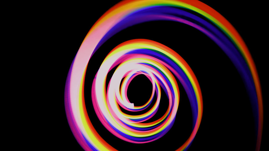 Cover Photo: A spiraling rainbow meant to convey the never-ending spiral and hypnotization of our endless streaming content