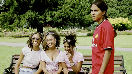 Cover Photo: A screenshot of Bend It Like Beckham with Jess (the film's heroine) in a soccer jersey and the girls in pink who sit on a bench