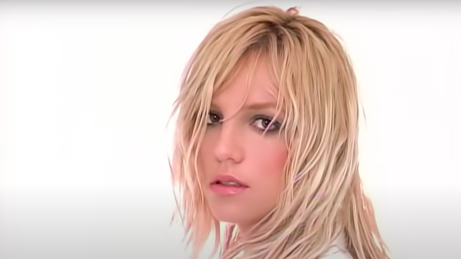 """Cover Photo: This image is a still taken from Britney Spears's music video for the song """"Everytime."""" She is looking over her shoulder against a white background."""