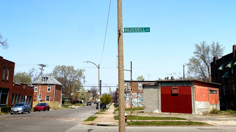 Cover Photo: A green sign for Russell Street on a bright blue day