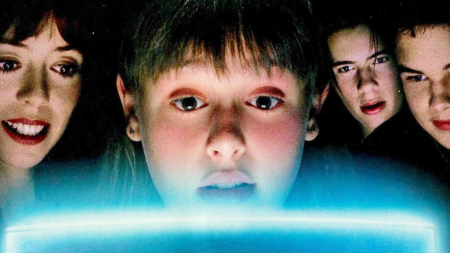 Cover Photo: A group of kids and teenagers staring entranced at a glowing orb