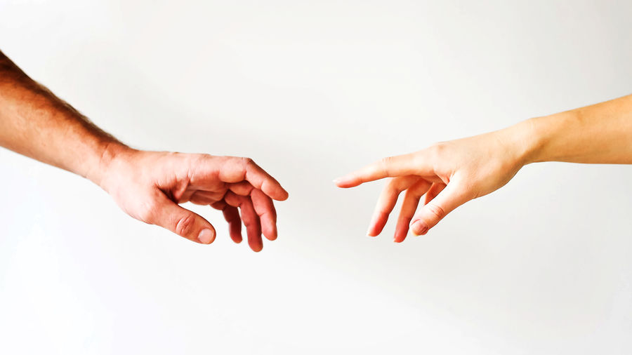 Cover Photo: Two hands reaching for each other, just short of touching