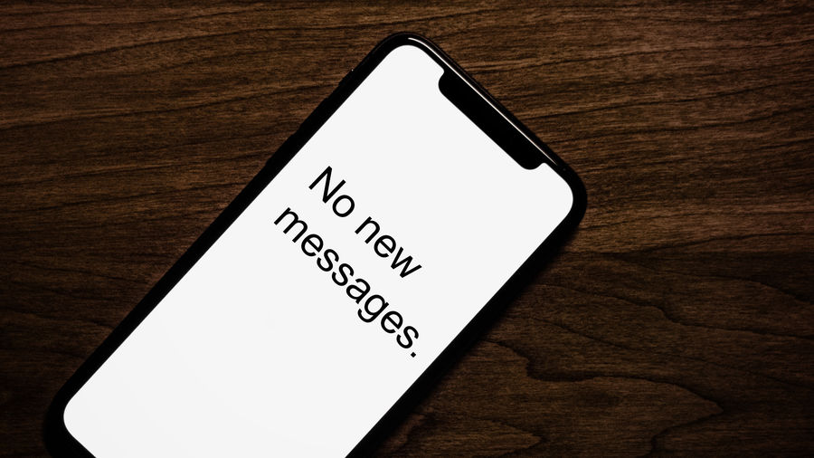 """Cover Photo: An image of an iphone that reads """"No new messages"""""""