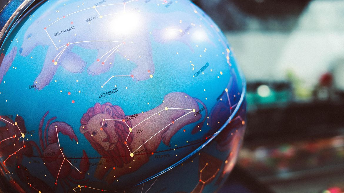 Cover Photo: This photograph shows a close up of a globe, but instead of the earth, we see constellations. There is a drawing of the constellation underneath the star points (for example, you can see a bear underneath ursa major and a lion under leo).