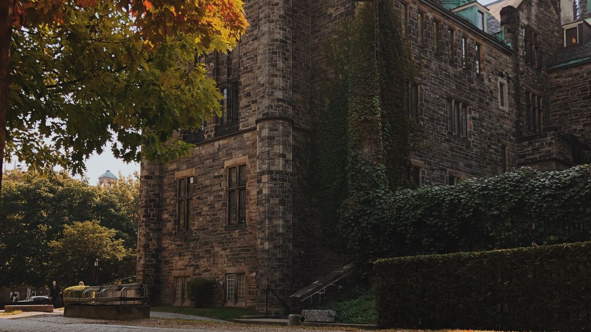 Cover Photo: This photograph shows an old campus building surrounded by fall foliage.