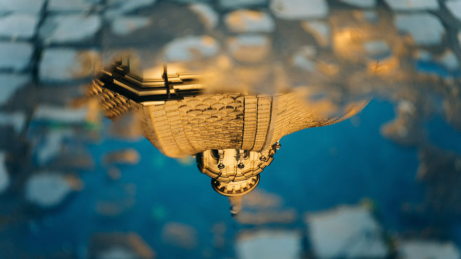 Cover Photo: A photograph of an Italian piazza reflected in a large puddle of water.