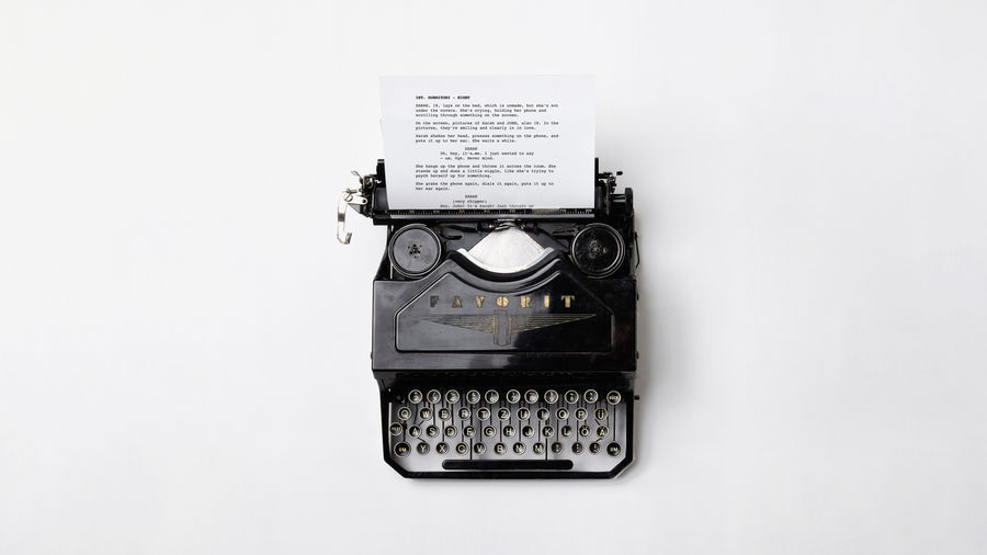 Cover Photo: This photograph shows a typewriter with a screenplay page sticking out of it.