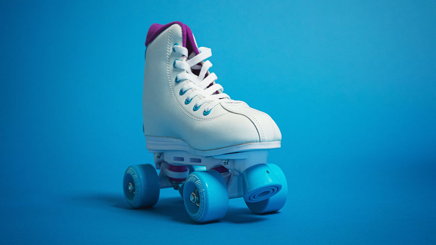 Cover Photo: White roller skates against a blue background