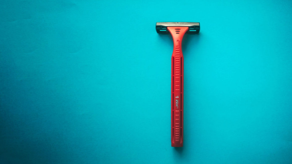 Cover Photo: An image of a razor against a blue background
