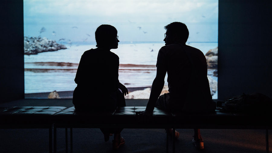 Cover Photo: Two human figures in silhouette having a conversation