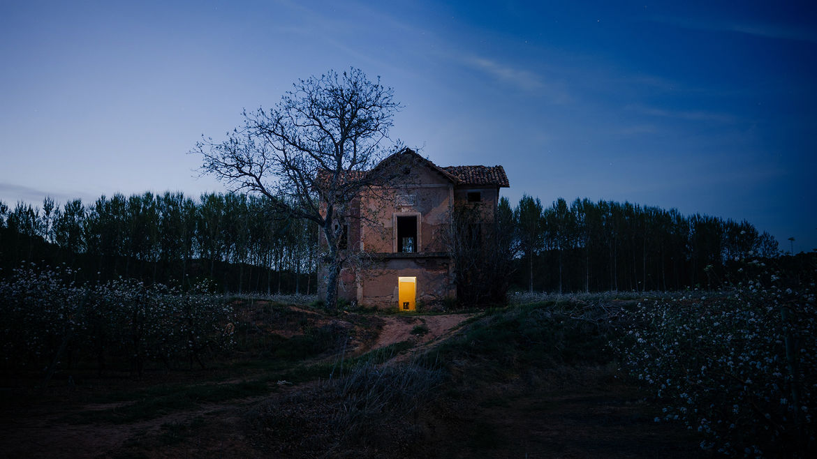 Cover Photo: An image of  a  desolate  house with a  single  window lit