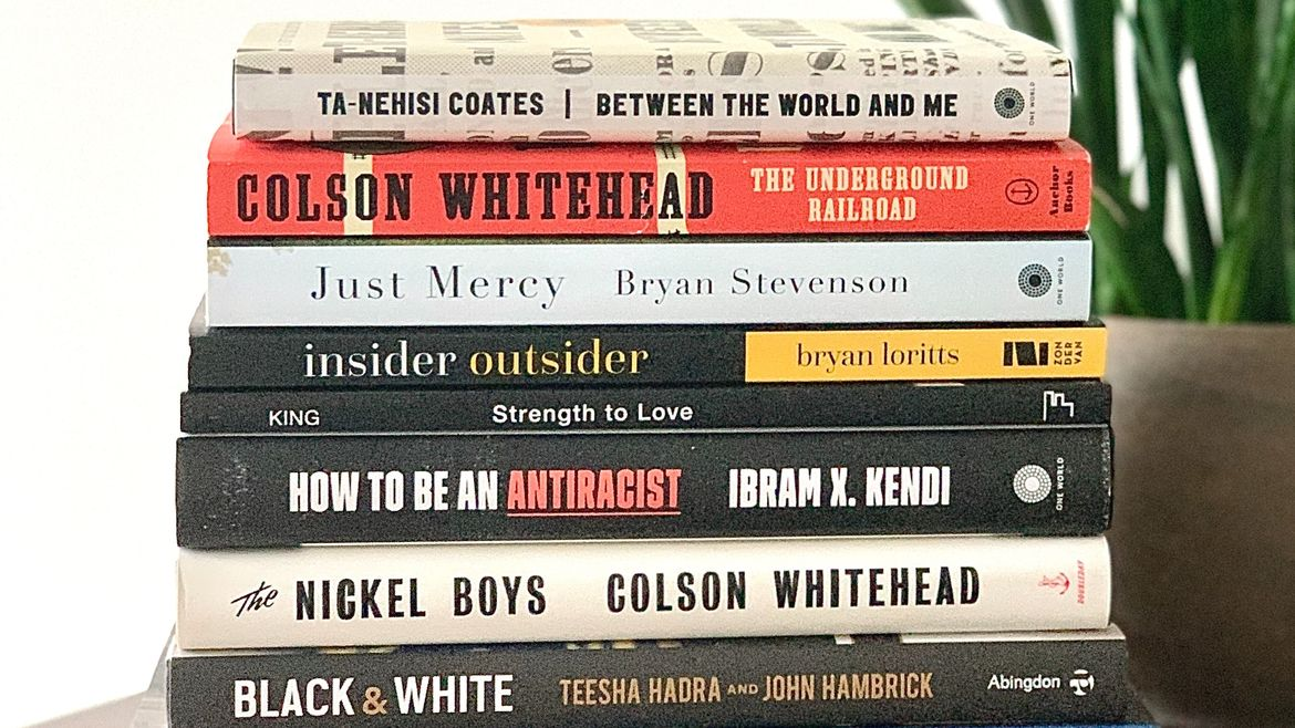 Cover Photo: A stack of books by Black writers including Colson Whitehead, Ta-Nehisi Coates, Bryan Stevenson, and Ibram X. Kendi sits atop a table.