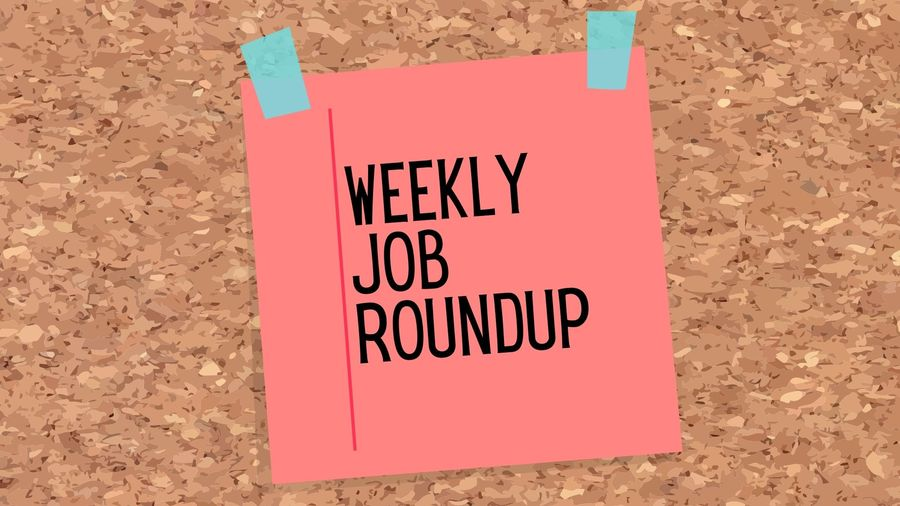 """Cover Photo: This graphic has a background that looks like a cork board. In the middle, a red sticky note with blue tap reads """"Weekly Job Roundup"""""""