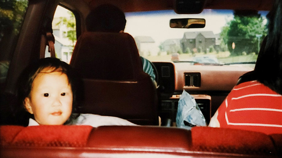Cover Photo: A photograph of the author as a toddler, sitting in the back seat of a car, looking at the camera