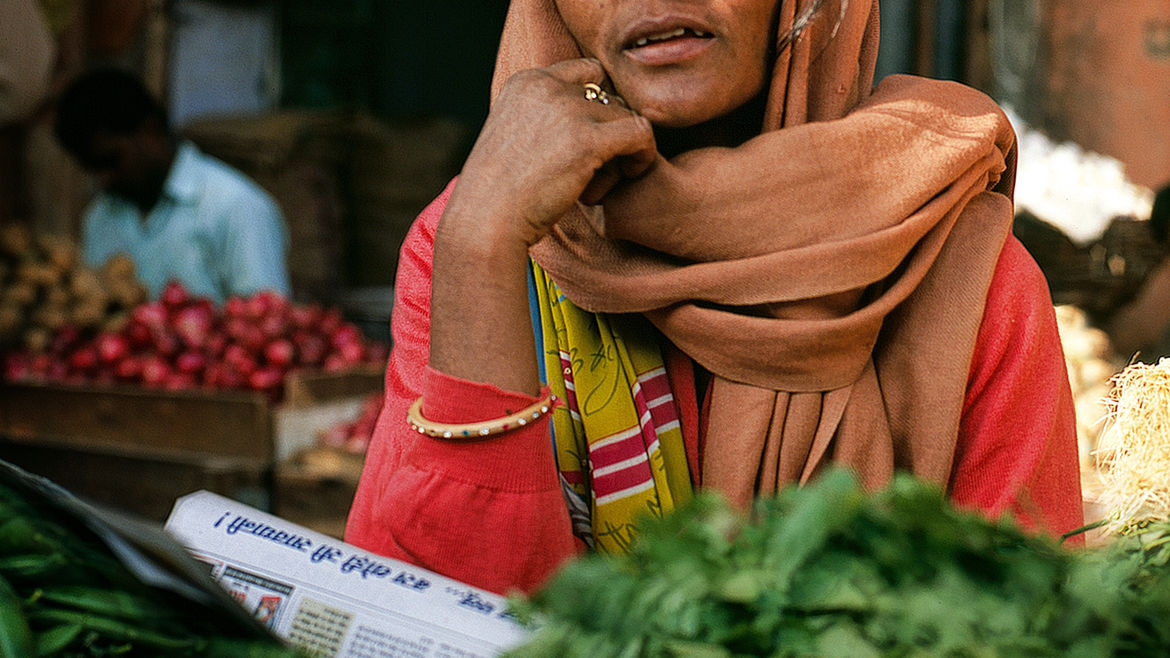 Cover Photo: An image of an Indian woman at a market