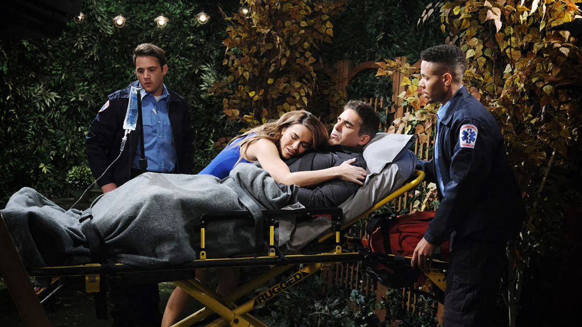 Cover Photo: A still from the TV show DAYS OF OUR LIVES, which shows two ambulance responders looking on in concern as a woman throws herself over a man on a stretcher in distress