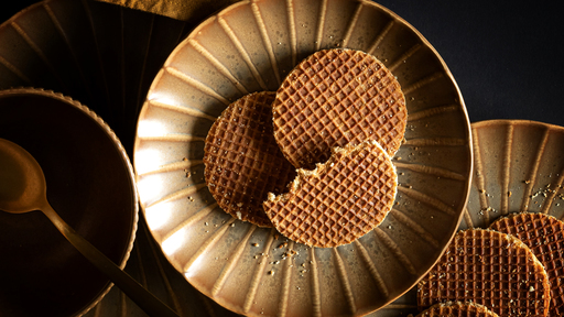 Cover Photo: A plate of stroopwafels—wafer-like cookie sandwiches with a thin filling of syrup