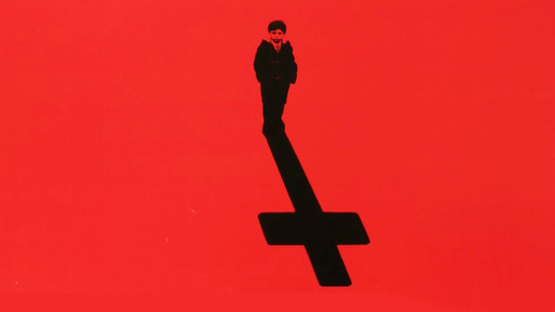 """Cover Photo: A detail from the movie poster for """"The Omen,"""" depicting a small child whose shadow takes the shape of a cross"""