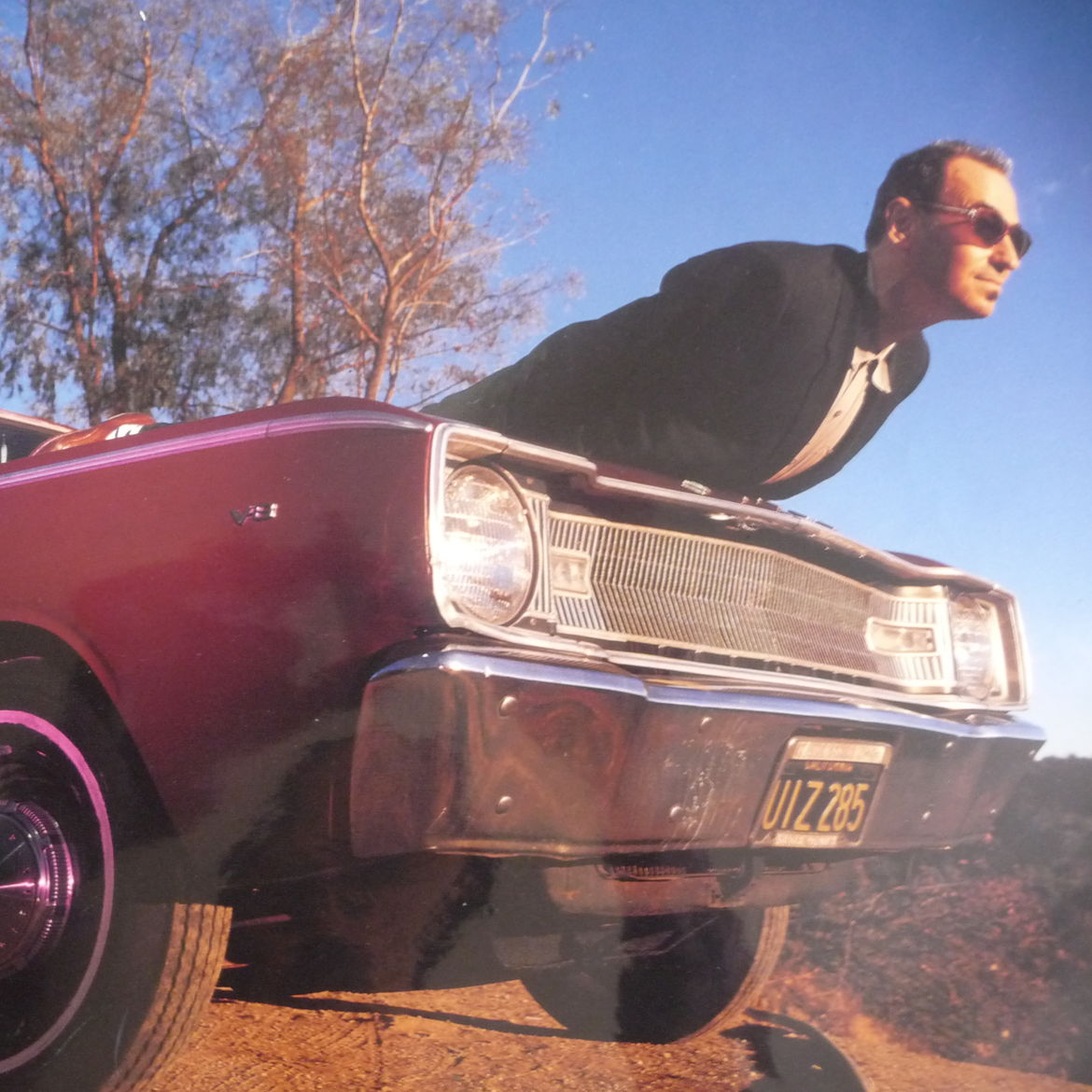 Cover Photo: Author aboard his '67 Dodge, Los Angeles, 1991. photo by Michael Grecco