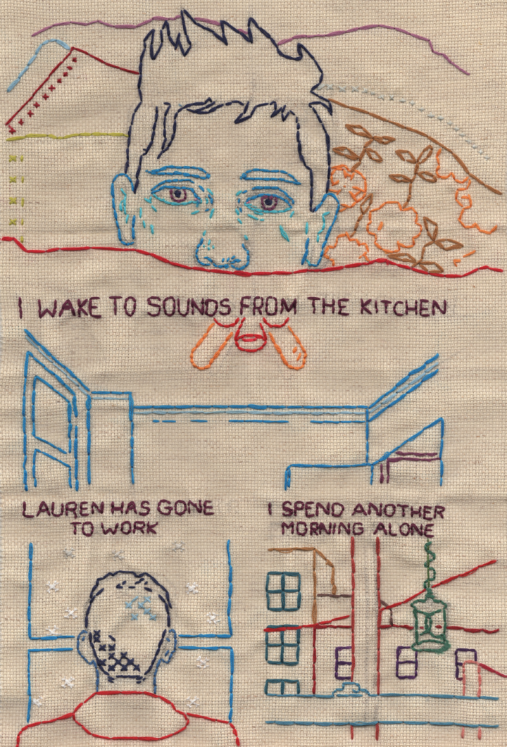 """An embroidered comic on tan fabric. The lines are colorful and sparse. In the top frame Andrew is waking up and in the bottom two he is looking out a window. The text reads """"I wake to sounds from the kitchen / Lauren has gone to work / I spend another morning alone."""""""